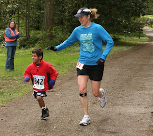 Melanie Springer Mock and her son, Sam, running in a local community event.