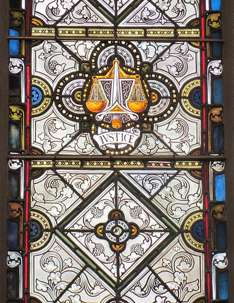 Stained Glass Window with Symbol of Justice
