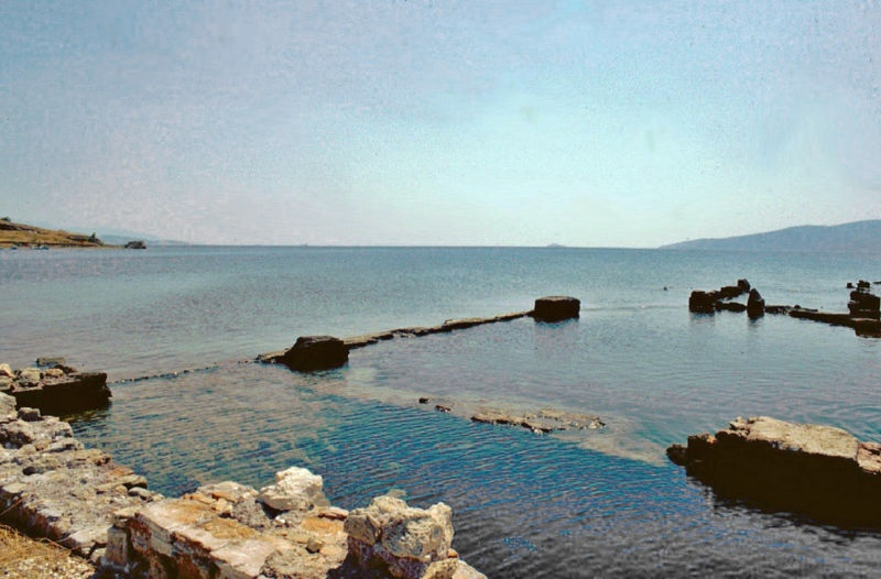 "The ancient harbor of Cenchreae on the Agaean Sea, where Phoebe led a house church not far from Corinth in Greece. Phoebe would have traveled at least 700 miles to reach Rome to read Paul's letter there.""Kenchreai"" by Heinz Schmitz from Wikipedia"