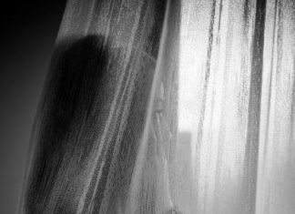 Woman behind a curtain