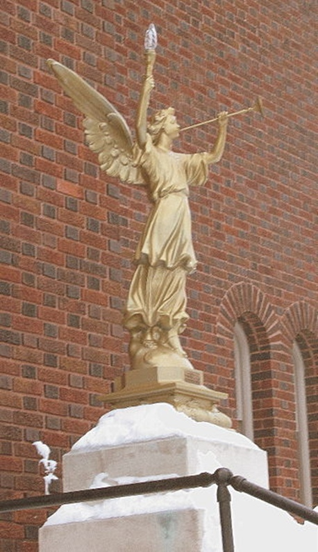 Basilica and National Shrine of Our Lady of Consolation in Carey, Ohio - statue of angel blowing trumpet outside