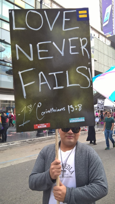 """Love Never Fails"" -- Sign at ResistMarch -- Photo by Anne Linstatter"