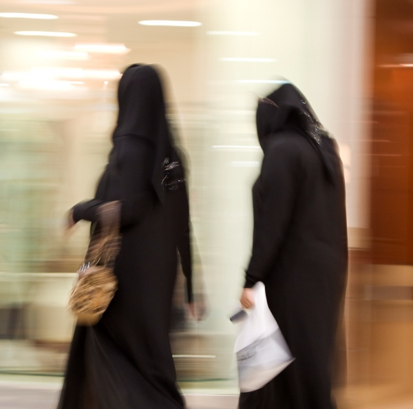 Two Muslim women wearing abayas