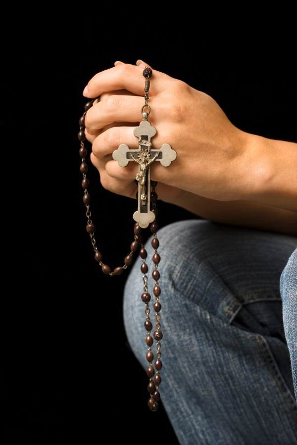 Woman holding a rosary