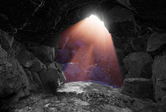 Sunlight streaming into a dark cave