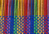A multicolor piece of weaving, partially done