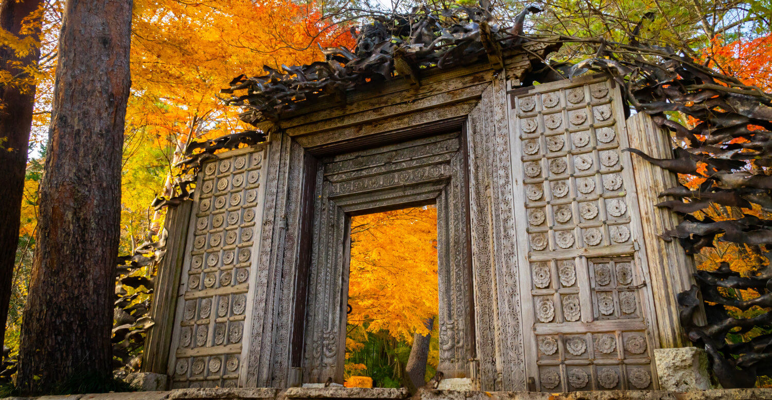 Ruin of a gate with autumn leaves in the background
