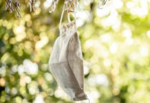 A facemask hanging on a clothes line